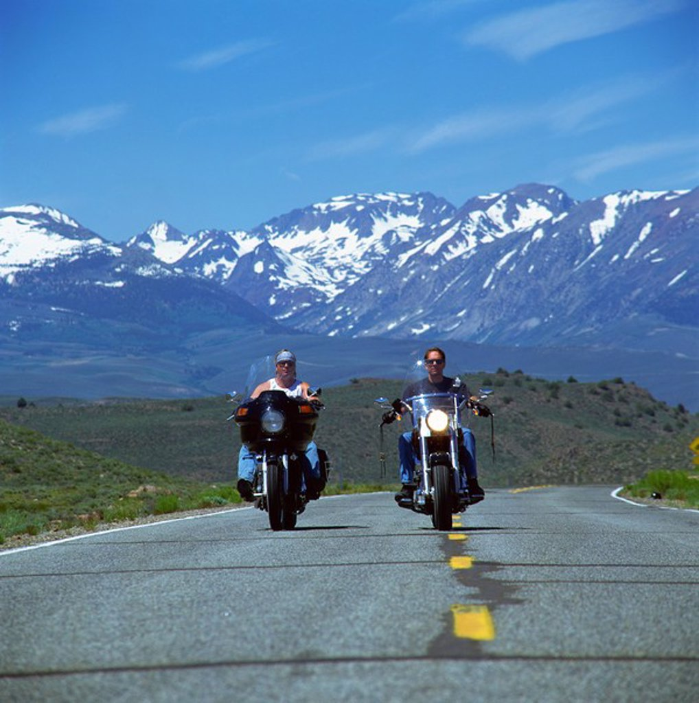 Stock Photo: 1890-6486 Harley Davidson bikers with snow_capped mountains in background, United States of America, North America