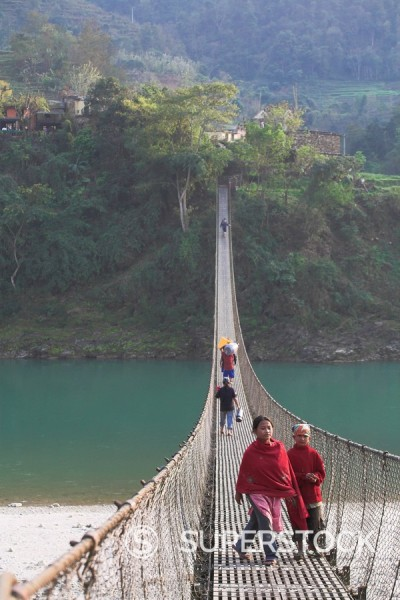 Stock Photo: 1890-66082 Local people crossing the 160m long suspension bridge, Trisuli Center, Bandare village, Trisuli Valley, Nepal, Asia