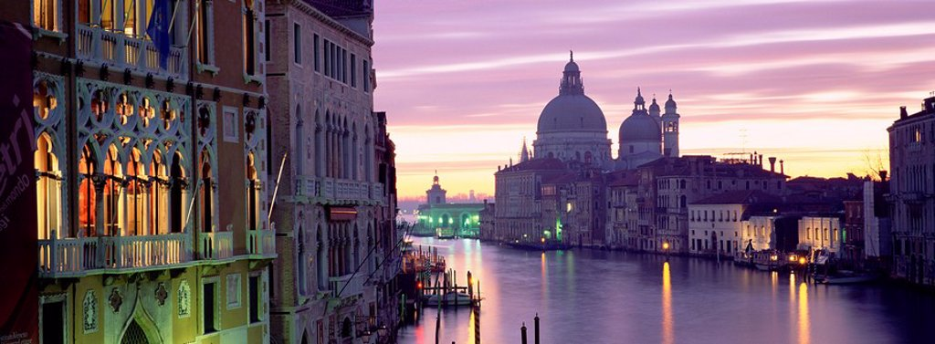 View at dusk along Grand Canal towards Santa Maria Della Salute from Accademia Bridge, Venice, UNESCO World Heritage Site, Veneto, Italy, Europe : Stock Photo