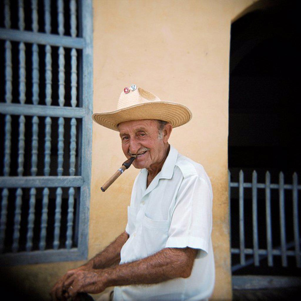 Stock Photo: 1890-66508 Old man smoking cigar, Trinidad, Cuba, West Indies, Central America