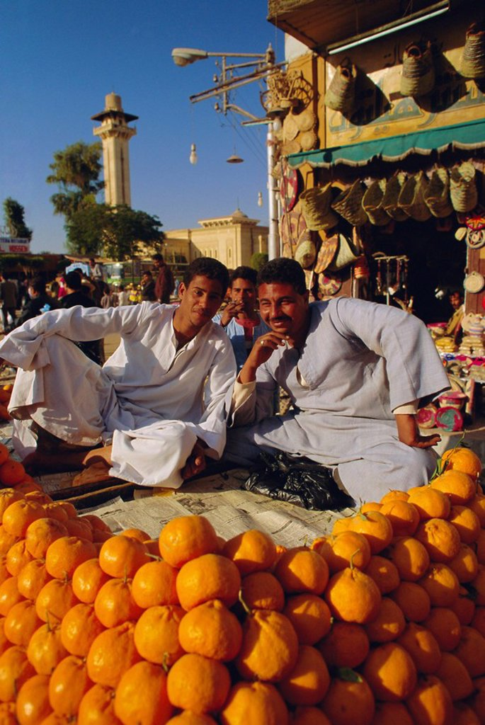 Stock Photo: 1890-67182 Market traders by their orange stall, Luxor, Egypt, North Africa