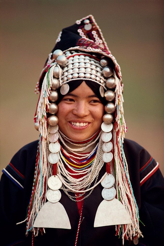 Portrait of a smiling woman of the Akha hill tribe wearing head_dress of silver and coins, in the Golden Triangle, Thailand, Southeast Asia, Asia : Stock Photo