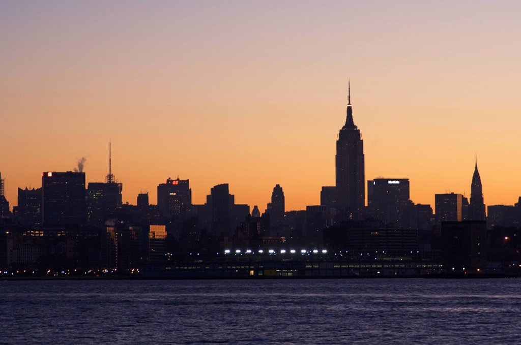 Stock Photo: 1890-68774 Empire State Building and Midtown Manhattan skyline at sunrise, New York City, New York, United States of America, North America