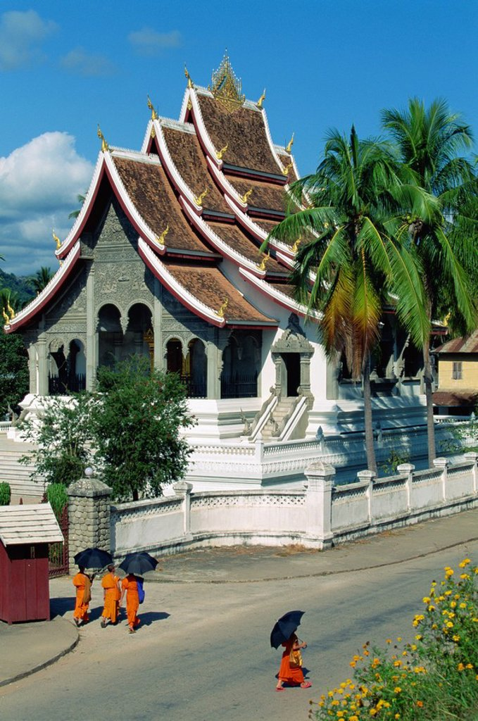 Stock Photo: 1890-6884 Monks in the street outside the Royal Palace Pavilion, which now serves as a museum showcase, Luang Prabang, Laos, Indochina, Southeast Asia, Asia