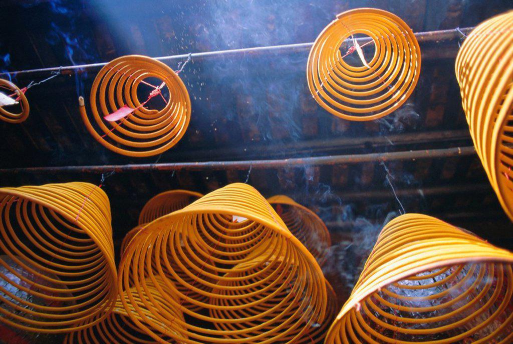 Stock Photo: 1890-68936 Burning incense at Kuanyin Temple, Ma Hang Village, Stanley Bay, Hong Kong Island, Hong Kong, China