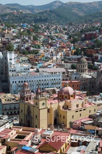 The Basilica de Nuestra Senora de Guanajuato, the yellow building in foreground, with the blue grey building of the University of Guanajuato behind, in Guanajuato, UNESCO World Heritage Site, Guanajuato State, Mexico, North America : Stock Photo
