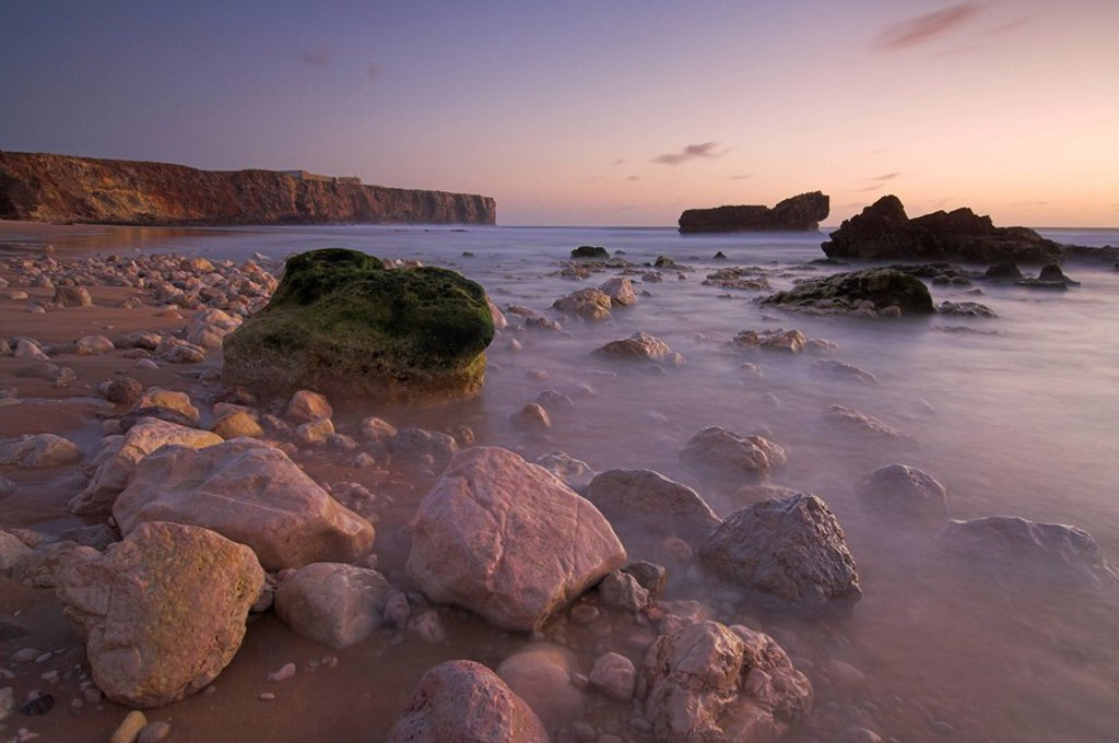 Stock Photo: 1890-73624 Long exposure of incoming tide on Tonal beach at sunset near Sagres, Algarve, Portugal, Europe