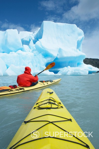 Person kayaking near icebergs, Lago Gray Lake Gray Lake Grey, Torres del Paine National Park, Patagonia, Chile, South America : Stock Photo