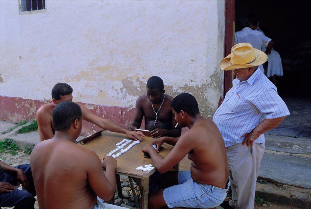 Stock Photo: 1890-75182 Group of men playing dominos, Trinidad, Sancti Spiritus, Cuba