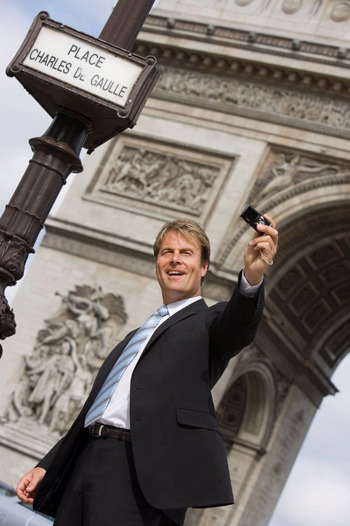 Stock Photo: 1890-77973 Business man taking picture, Paris, France, Europe