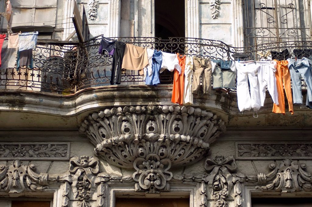 Laundry hanging in front of an ornate old building on the Paseo del Prado, Havana, Cuba, West Indies, Central America : Stock Photo