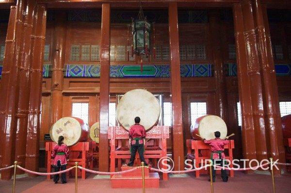 Stock Photo: 1890-79537 Drummers inside The Drum Tower, a later Ming dynasty version originally built in 1273 marking the centre of the old Mongol capital, Beijing, China, Asia
