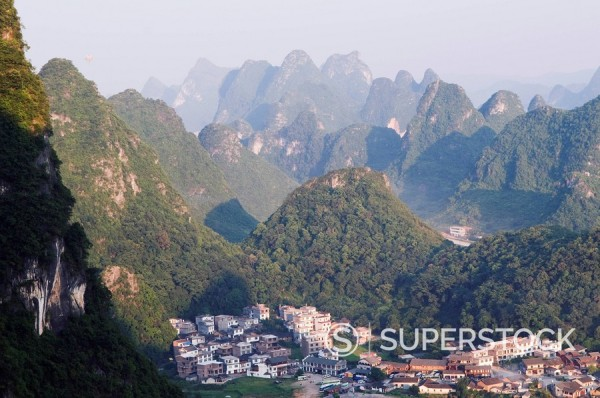 Karst limestone scenery surrounding a village in Yangshuo, near Guilin, Guangxi Province, China, Asia : Stock Photo