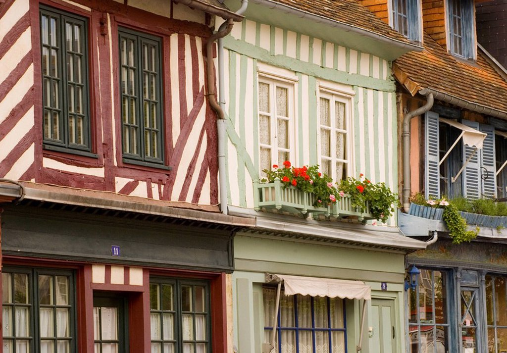 Colourful half timbered houses with geranium filled flower boxes in Beaumont en Auge, Normandy, France, Europe : Stock Photo