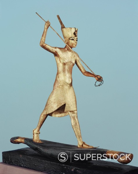Gilt wood statuette of Tutankhamun on a boat with a harpoon, from the tomb of the pharaoh Tutankhamun, discovered in the Valley of the Kings, Thebes, Egypt, North Africa, Africa : Stock Photo