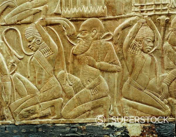 Detail from a state chariot showing the vanquished and enslaved enemies of Egypt, from the tomb of the pharaoh Tutankhamun, discovered in the Valley of the Kings, Thebes, Egypt, North Africa, Africa : Stock Photo
