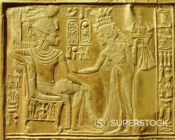 Detail of the exterior of the gilt shrine showing the queen bringing unguents and flowers to the king, from the tomb of the pharaoh Tutankhamun, discovered in the Valley of the Kings, Thebes, Egypt, North Africa, Africa : Stock Photo