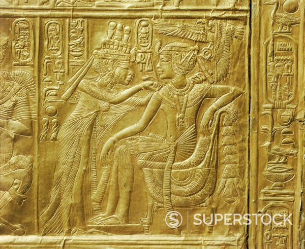 Detail of the exterior of the gilt shrine showing the queen fastening a necklace around the king´s neck, from the tomb of the pharaoh Tutankhamun, discovered in the Valley of the Kings, Thebes, Egypt, North Africa, Africa : Stock Photo