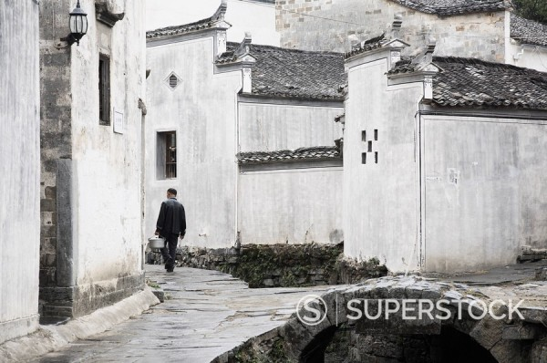 Stock Photo: 1890-83117 Man walking in the street, Xi Di Xidi village, UNESCO World Heritage Site, Anhui Province, China, Asia