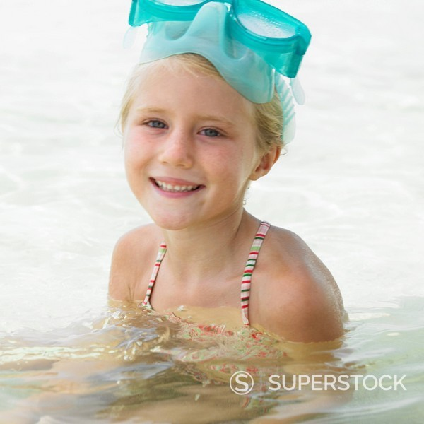 Stock Photo: 1890-84578 Girl 6_8 wearing swimming goggles in the surf