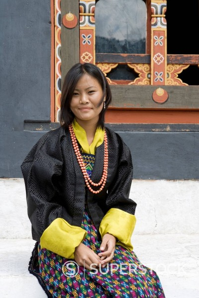 Bhutanese woman in typical dress at Buddhist festival Tsechu, Trashi Chhoe Dzong, Thimphu, Bhutan, Asia : Stock Photo