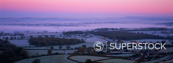 Stock Photo: 1890-86428 View over frosty countryside and farmland in winter at dawn from Bullbarrow Hill near Dorchester, Dorset, England, United Kingdom, Europe