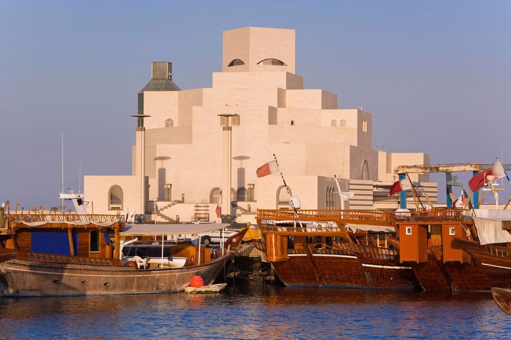 Stock Photo: 1890-87417 Dhow in front of the Museum of Islamic Art, designed by the renowned architect IM Pei, which has the largest collection of Islamic art in the world, Doha, Qatar, Middle East