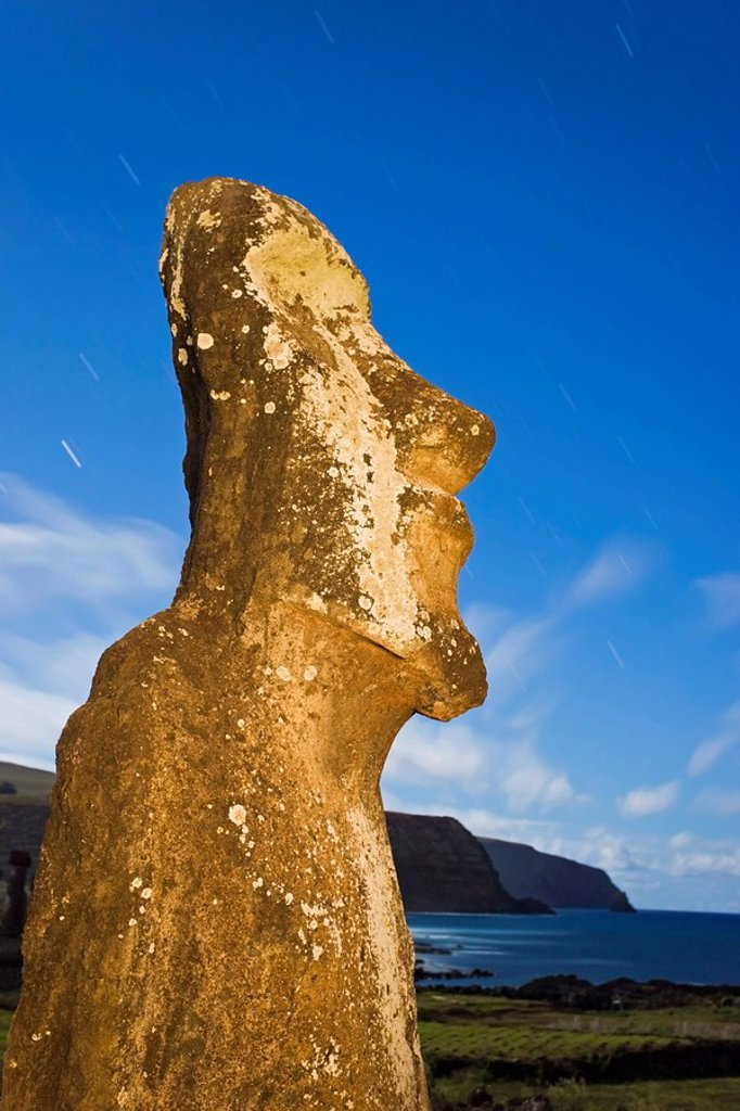 Lone monolithic giant stone Moai statue looking out to sea at Tongariki, Rapa Nui Easter Island, UNESCO World Heritage Site, Chile, South America : Stock Photo