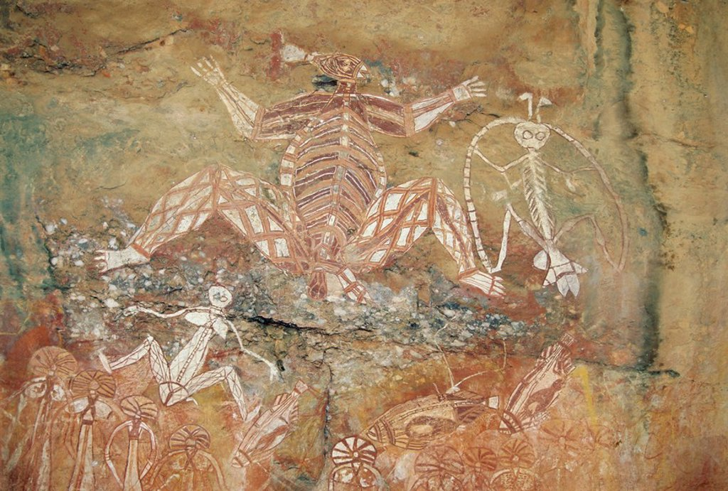 Stock Photo: 1890-88016 Namondjok centre who ate his clan sister, Namarrgon right , the Lightning Man and Barrginj his wife below left supernatural ancestors at the rock art site at Nourlangie Rock, Kakadu National Park, Northern Territory, Australia