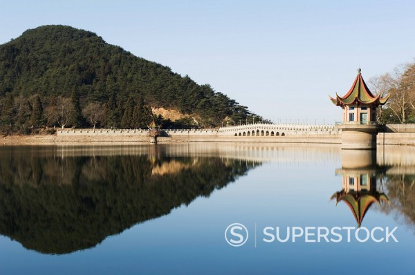 An ancient bridge reflected in the waters of a reservoir at Lushan mountain, UNESCO World Heritage Site, Jiangxi Province, China, Asia : Stock Photo