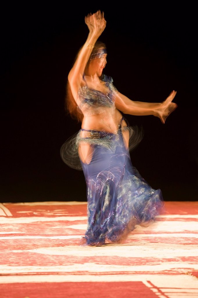 Stock Photo: 1890-93106 Belly dancer performing a traditional dance in the open air at night, near Abu Dhabi, United Arab Emirates, Middle East