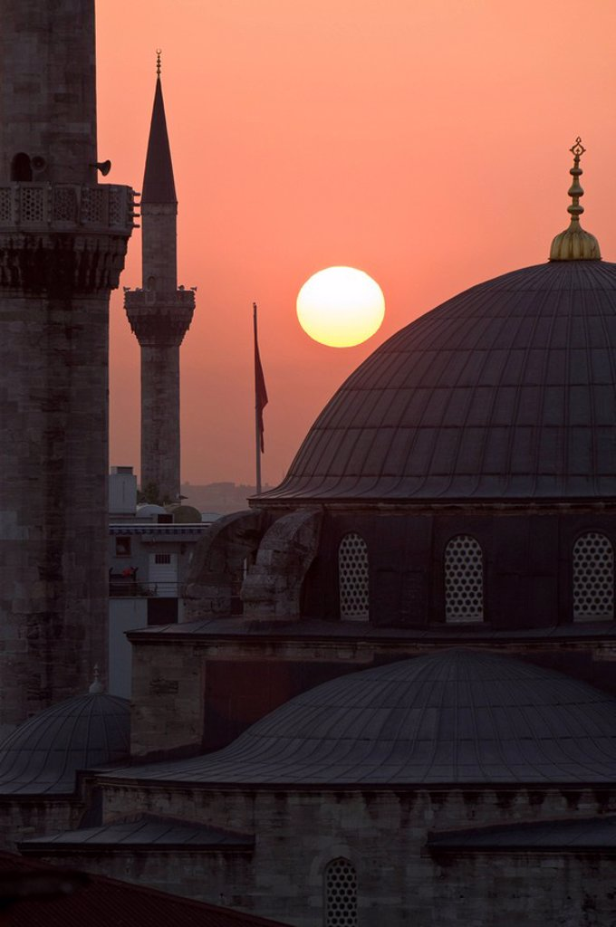 Sun setting behind Mahamut Pasha Mosque, Istanbul, Turkey, Europe : Stock Photo