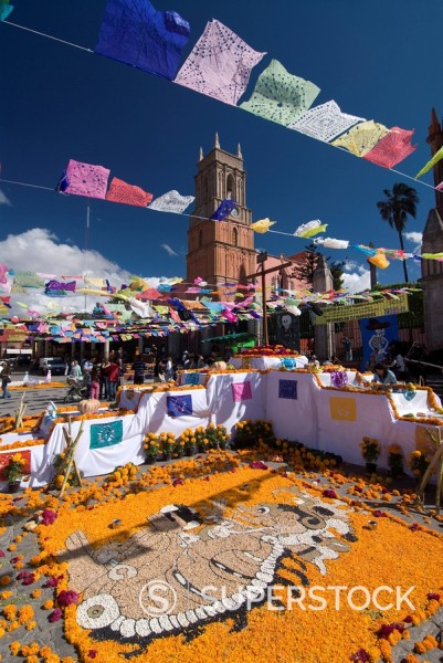 Decorations for the Day of the Dead festival with Iglesia de San Rafael in the background, Plaza Principal, San Miguel de Allende, Guanajuato, Mexico, North America : Stock Photo