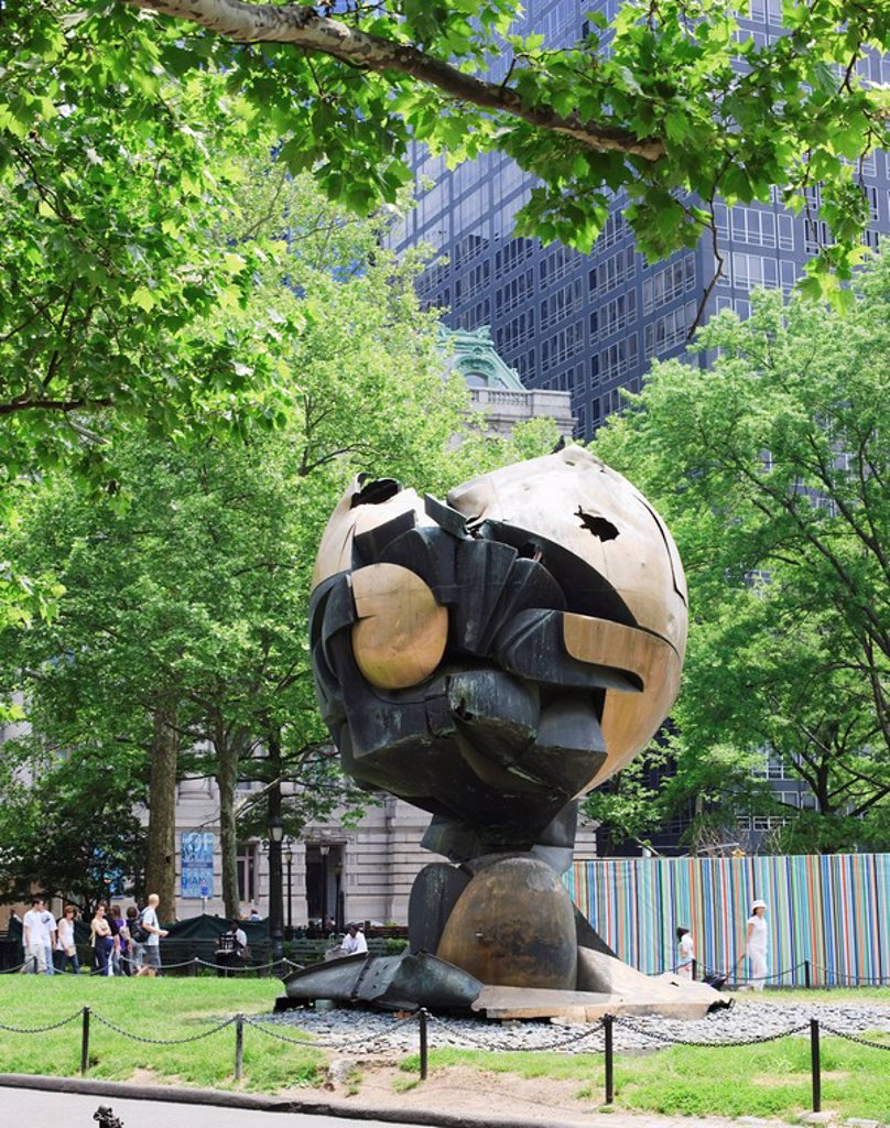 Stock Photo: 1890-94428 The Sphere, originally stood at the World Trade Center it was damaged during the 9 11attack and subsequently moved to Battery Park where it now stands as a memorial, New York City, New York, United States of America, North America
