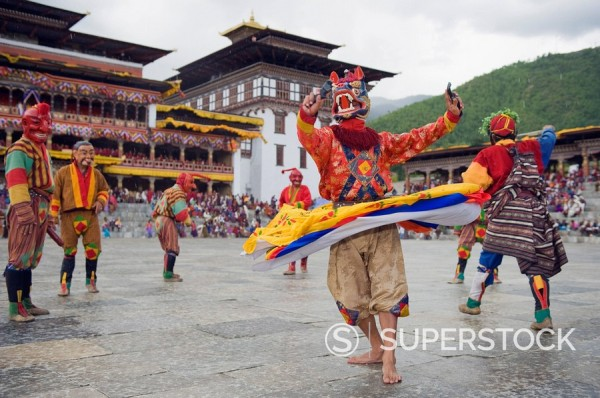 Stock Photo: 1890-97430 Dancers in traditional costume, Autumn Tsechu festival at Trashi Chhoe Dzong, Thimpu, Bhutan, Asia