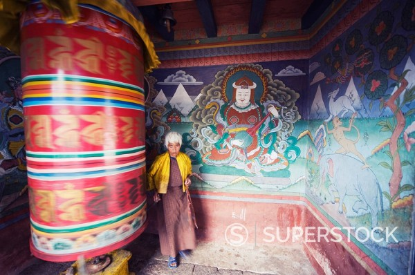 Stock Photo: 1890-97456 A woman spinning a prayer wheel, Chimi Lhakhang dating from 1499, Temple of the Divine Madman Lama Drukpa Kunley, Punakha, Bhutan, Asia