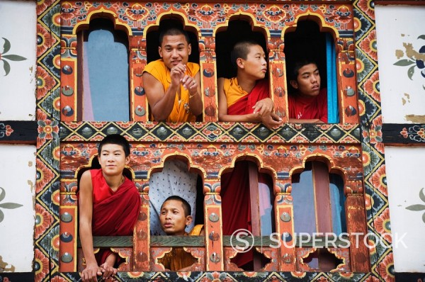 Stock Photo: 1890-97457 Young monks at a window, Chimi Lhakhang dating from 1499, Temple of the Divine Madman Lama Drukpa Kunley, Punakha, Bhutan, Asia