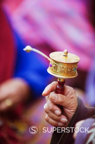 Stock Photo: 1890-97621 Prayer wheels being spun by a pilgrims at the National Memorial Chorten, Thimphu, Bhutan, Asia