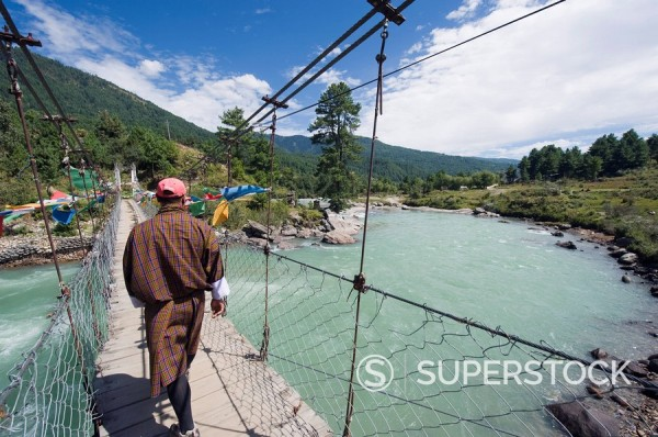 Local man crossing a bridge, Bumthang, Chokor Valley, Bhutan, Asia : Stock Photo