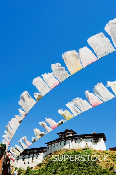 Stock Photo: 1890-97688 Prayer flags below Wangdue Phodrang Dzong, founded by the Zhabdrung in 1638, Bhutan, Asia