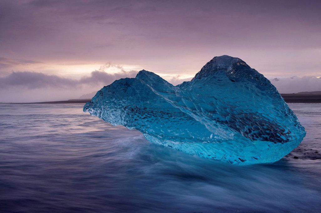 Stock Photo: 1890-99359 Translucent blue iceberg washed ashore on Breidamerkursandur black sands, near Jokulsarlon glacial lagoon, East Iceland, Polar Regions