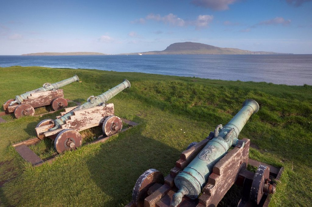 Stock Photo: 1890-99500 Skansin fort, old fort guarding Torshavn and its harbour, with old brass cannons, Second World War British marine guns and lighthouse, Nolsoy in the distance, Torshavn, Streymoy, Faroe Islands Faroes, Denmark, Europe