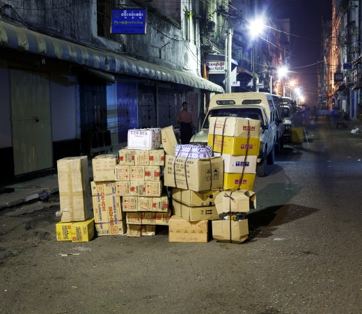 Stack of cardboard boxes in a street, Myanmar : Stock Photo