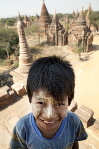 Portrait of a boy at a temple, Bagan Temple, Bagan, Myanmar : Stock Photo