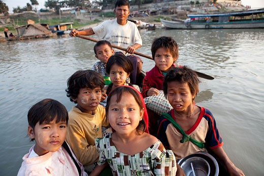 Children on a boat, Myanmar : Stock Photo