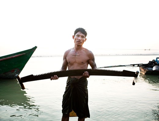 Stock Photo: 1891-166 Man holding a saw, Myanmar