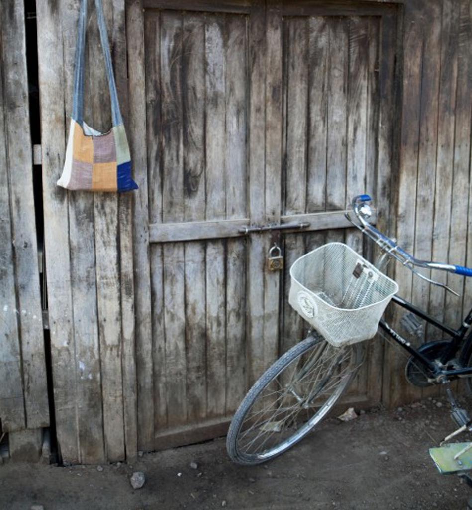Bicycle in front of a door, Myanmar : Stock Photo