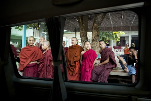 Monks viewed through the window of a car, Myanmar : Stock Photo