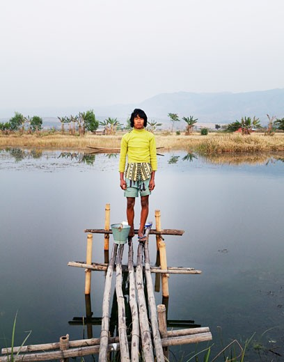 Boy standing on a pier, Myanmar : Stock Photo