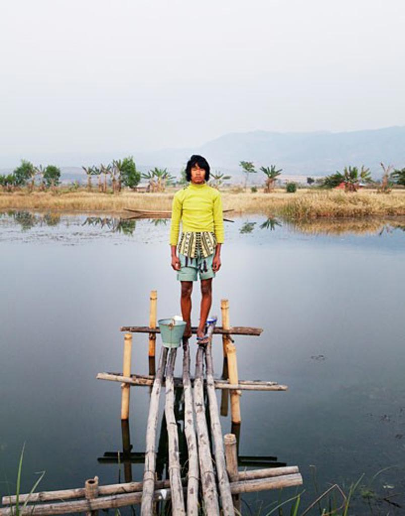 Stock Photo: 1891-211 Boy standing on a pier, Myanmar